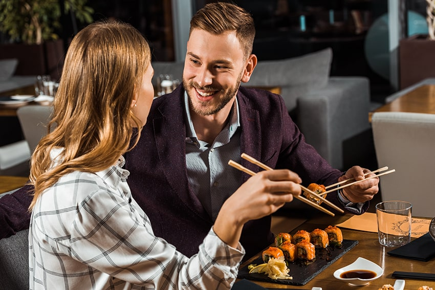 couple enjoying sushi together